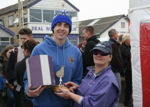 Chris Hall receiving the Keith Thomsett Memorial Trophy from Deal's Jane Shorter